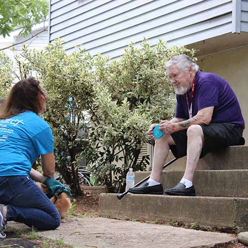 Elderly man talking to a 516 project volunteer on his home porch -516 Project of Fredericksburg Virginia