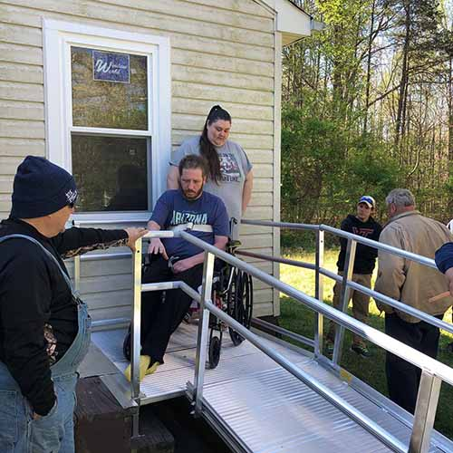 Disabled man in wheelchair and his wife on his new aluminum ramp in front of his home -516 Project of Fredericksburg Virginia