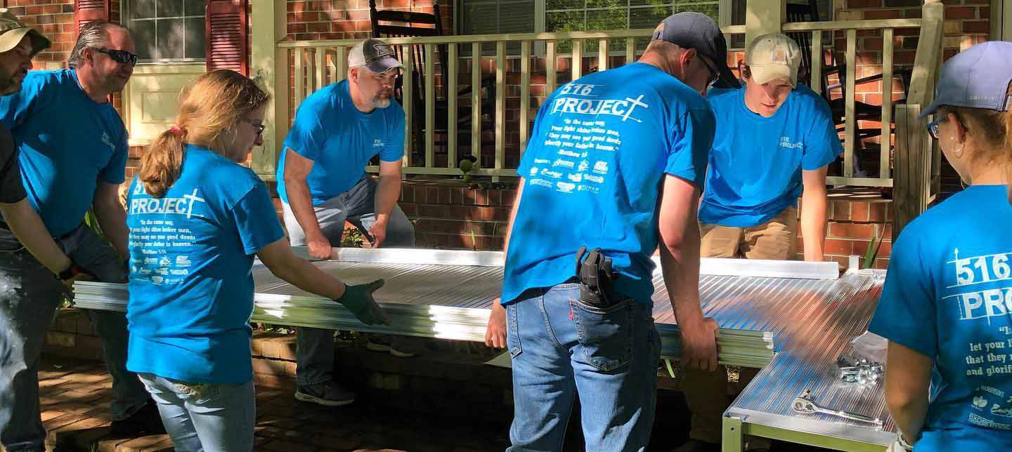 516 Project volunteers installing an aluminum ramp - 516 Project Fredericksburg Virginia